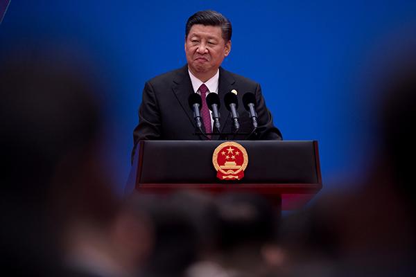 Xi-Jinping-podium-R-600