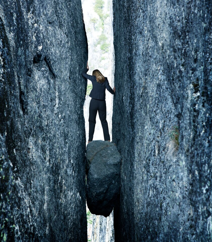 rock-hard-place-businesswoman-sme-istock-780.jpg